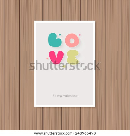 Valentine's day greeting card on a wooden background - stock vector