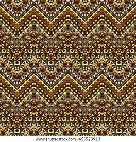 Vector african style chevron pattern with tribal motifs. Natural and elegant ornament with geometric hand drawn decorative stripes for prints, fabrics, backgrounds in brown, ochre and yellow colors