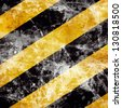 Vector black and yellow hazard lines with grunge effects - stock vector