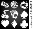 Vector black casino icons set on black - stock vector