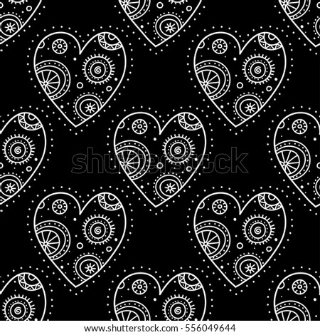 Vector boho ornamental hearts seamless pattern on black background. Can be printed and used as wrapping paper, wallpaper, textile, fabric, etc.