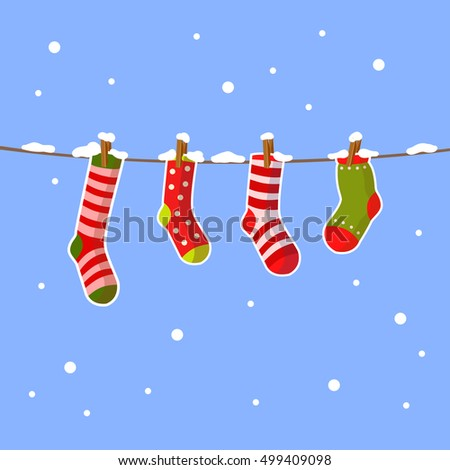 Vector christmas socks hanging on a rope with snowflakes around. Cute winter illustration. Cartoon x-mas picture.