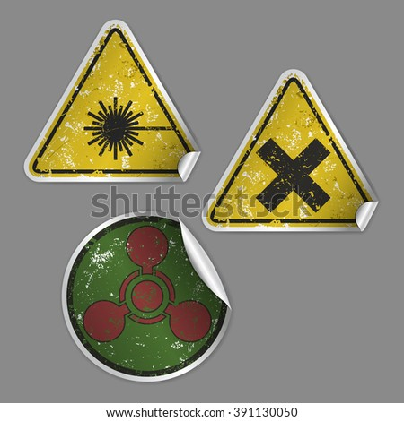 """Vector collection of three realistic grunge stickers consists of """"Laser Hazard"""", """"Harmful"""" and """"Chemical Weapon"""" signs. Fully editable isolated set for your projects. Eps 10 file. - stock vector"""