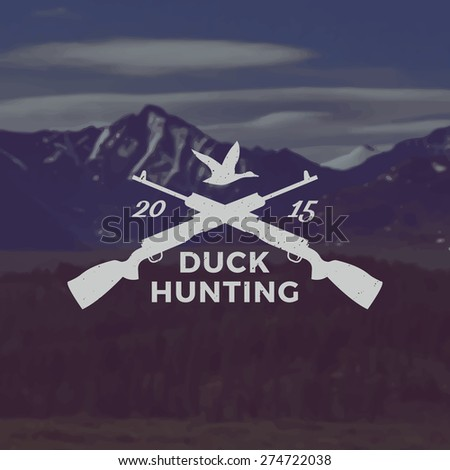vector duck hunting emblem with grunge texture on mountain landscape background - stock vector