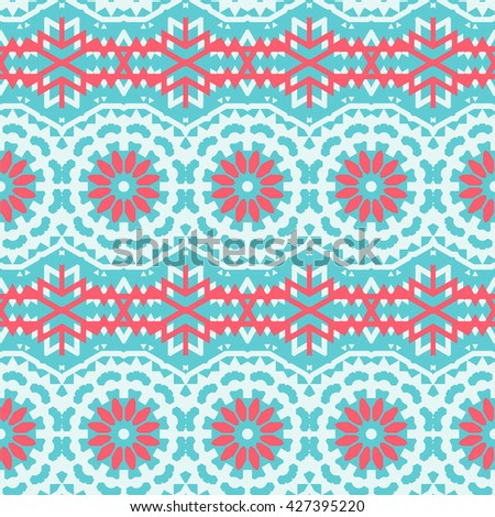 Vector ethnic colorful bohemian pattern in bright blue colors with big abstract flowers. Geometric background with Indian, Moroccan, Aztec ethnic motifs. Bold tribal print for spring summer fashion