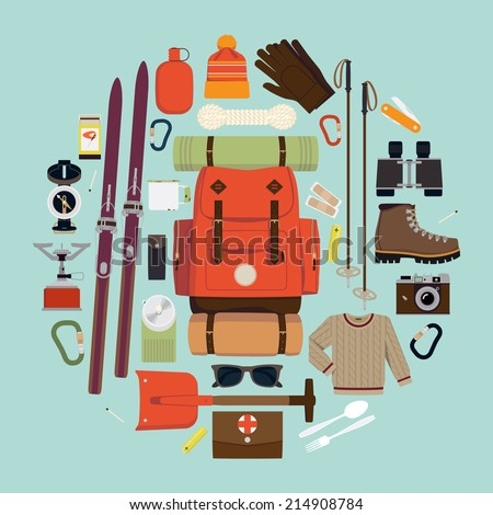 Vector flat circle composition of winter hiking gear | Large set of snowy backpack trip equipment | Winter exploring essentials featuring touring skis, hiking boots, shovel, binoculars, compass - stock vector