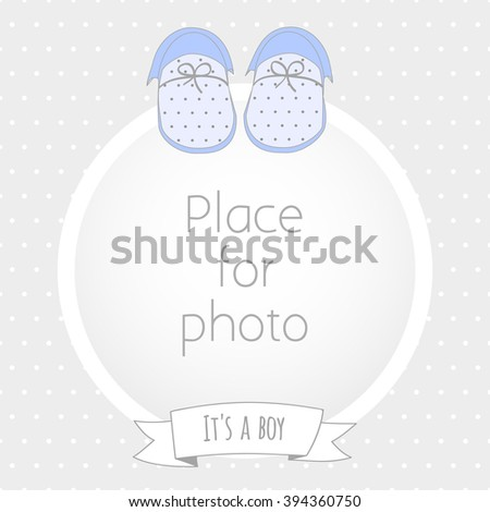 Vector frame for a photo with blue baby booties and and inscription It's a boy. Background polka dot pattern. Scrapbooking album page - stock vector