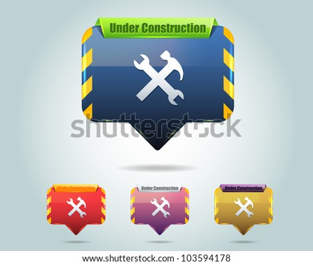 Vector Glossy Under Construction Icon/Button and multicolored - stock vector