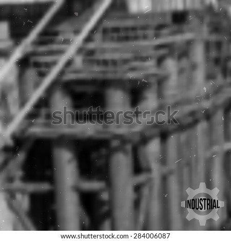 Vector grunge black and white blurred industrial background with label.