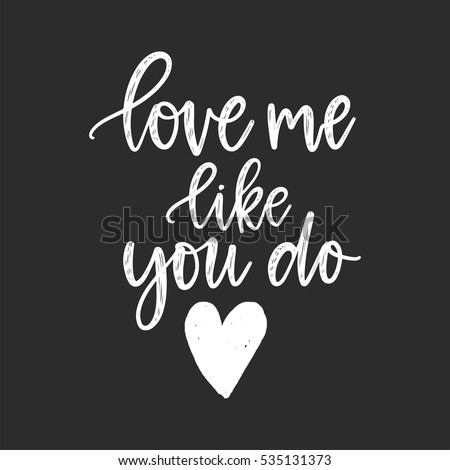 Vector hand drawn greeting card - Love me like you do. White calligraphy isolated on black background. Valentine's Day design