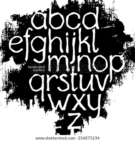 vector handcrafted decorative typeface with crooked letters on the background of black ink stain - stock vector