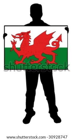 vector illustration of a  man holding a flag of wales - stock vector