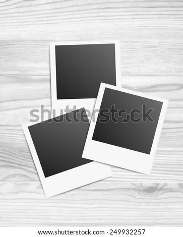 Vector illustration of 3 blanks photo frames on white wood background
