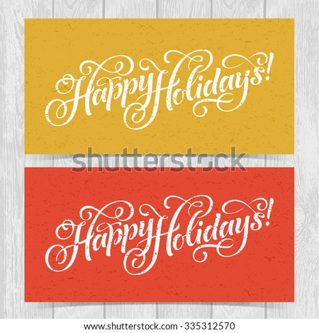 Vector illustration of colorful paper cards with Happy Holidays lettering and ornamental elements. Christmas calligraphy on wood background. - stock vector