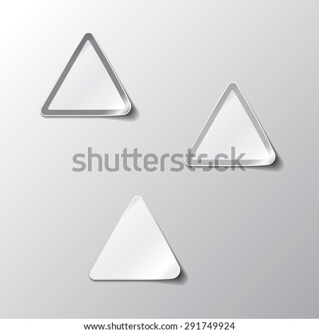Vector illustration of Realistic Triangle Stickers or Notes. With peeled off corner and shadow. Place for your text. EPS 10. Black and white set. - stock vector
