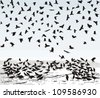 Vector illustration of the crows on the snowy field - stock vector
