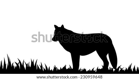 Vector illustration the silhouette of wolf in the grass. - stock vector