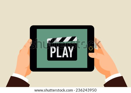 Vector modern flat design background on hands holding tablet computer with multimedia player icon on screen | Clapperboard icon with 'Play' title displayed on mobile computer - stock vector