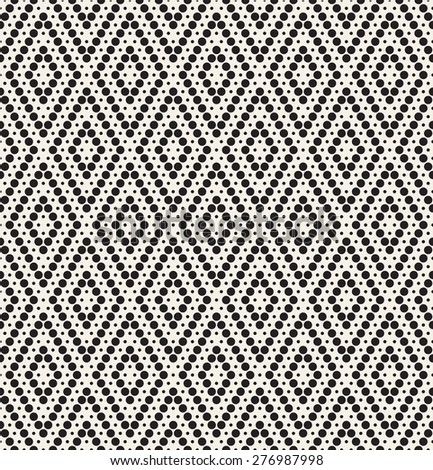 Vector seamless pattern. Modern stylish texture. Repeating geometric tiles with dotted rhombuses. Monochrome graphic design.