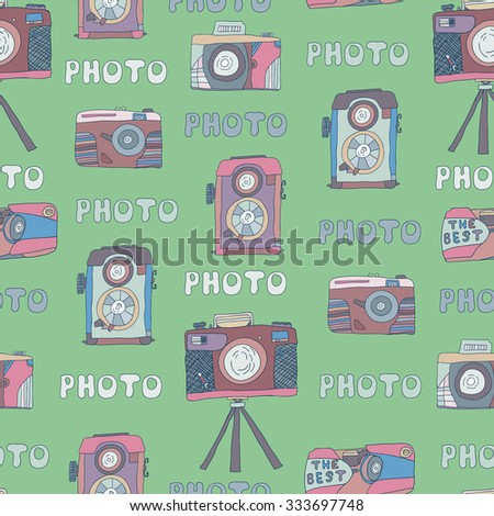Vector seamless pattern of cameras photos doodles . Hand-drawn background .