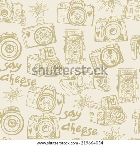 Vector seamless pattern with cute retro cameras. - stock vector