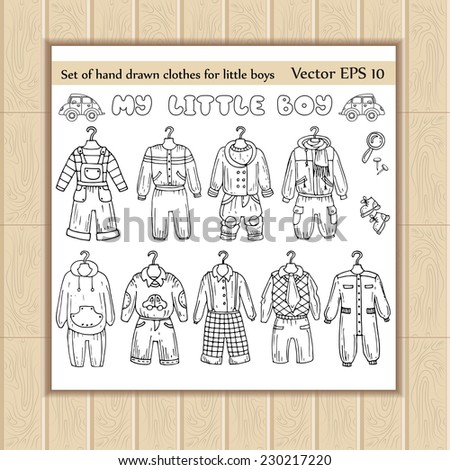 Vector set of hand drawn clothes for little boys. Sketches of clothes for use in design - stock vector
