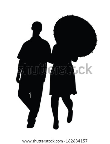 Vector Silhouette of a couple walking with an umbrella