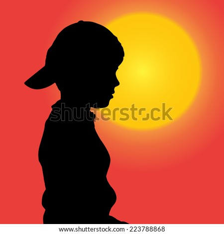 Vector silhouette of a small boy at sunset.