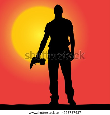 Vector silhouette of a worker at sunset.