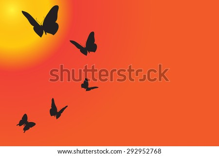 Vector silhouette of butterflies are flying at sunset.