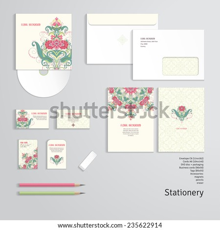 Vector templates. Beautiful oriental floral pattern. Delicate green and pink. Envelope, cards, business cards, tags, disc with packaging, pencils, eraser. - stock vector