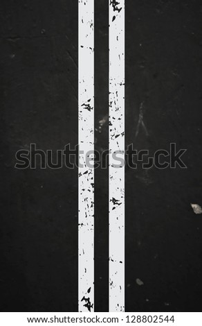 Vector textured asphalt road with cracked white marking - stock vector