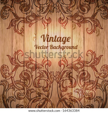 Vector vintage baroque engraving floral scroll filigree design on wood texture
