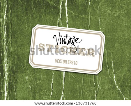 Vector vintage crumpled paper sticker over old distressed green cardboard background - stock vector