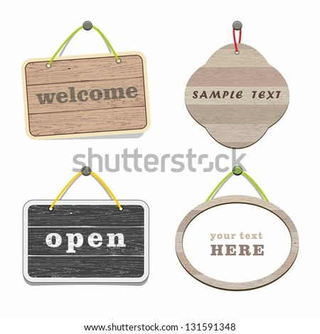 Vector wood frames on wall. Hanging signboard. - stock vector