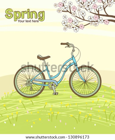 Vintage bicycle on the spring meadow