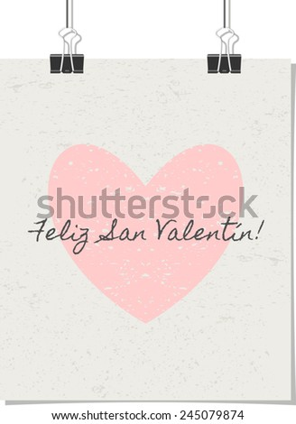"""Vintage style poster for Valentine's Day with a pastel pink heart and text. """"Feliz San Valentin!"""" - Spanish for """"Happy Valentine's Day!"""". Poster design mock-up with paper clips, isolated on white. - stock vector"""