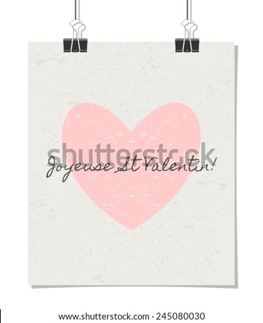 """Vintage style poster for Valentine's Day with a pastel pink heart and text. """"Joyeuse St. Valentin!"""" - French for """"Happy Valentine's Day!"""". Poster design mock-up with paper clips, isolated on white. - stock vector"""