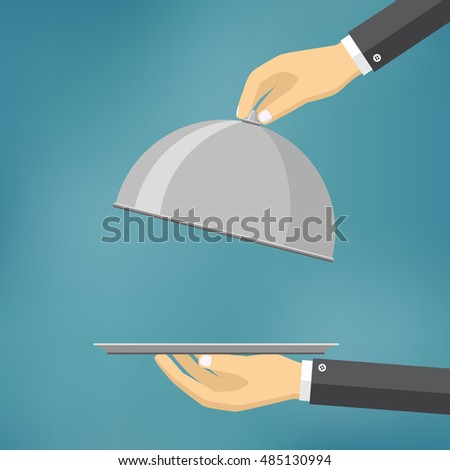 Waiter holding an empty cloche on the blue background.