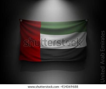waving flag United Arab Emirates on a dark wall with a spotlight, illuminated - stock vector