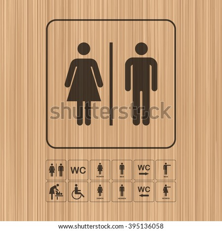WC - Toilet door/wall plate. Original WC icons set on wooden background. - stock vector