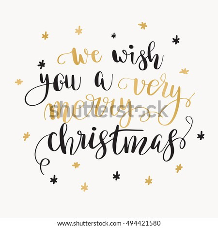 We wish you a very merry Christmas. Christmas greeting card with calligraphy. Handwritten modern brush lettering. Black and gold quote on white background