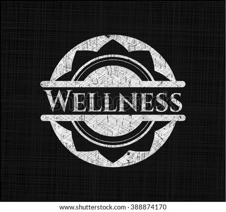 Wellness chalkboard emblem written on a blackboard - stock vector