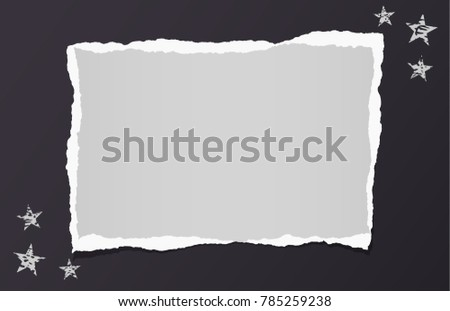 White ripped blank note, notebook paper for text or message stuck on black background with stars.