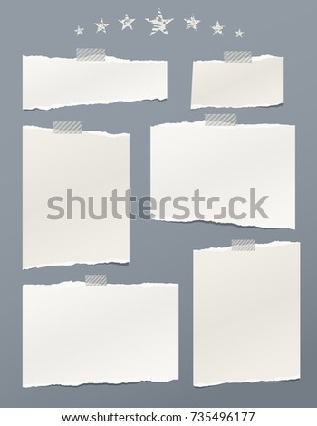 White ripped paper, notebook sheets for note or message stuck with sticky tape on gray background with stars.