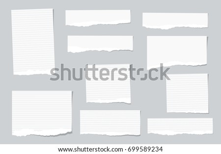 White ripped ruled, lined note, copybook, notebook paper strips stuck on grey background.