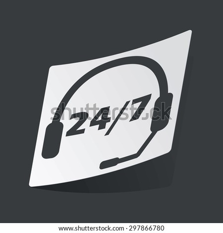 White sticker with black headset and text 24 per 7, on black background - stock vector