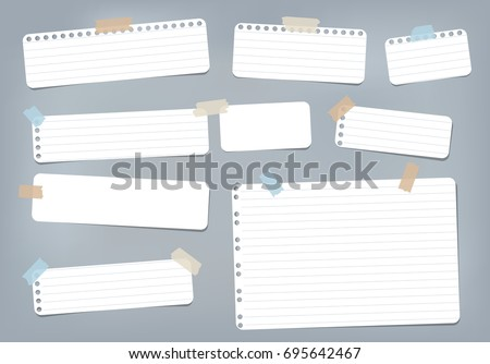 White striped, ruled note, copybook, notebook paper stuck with sticky tape on blue background.