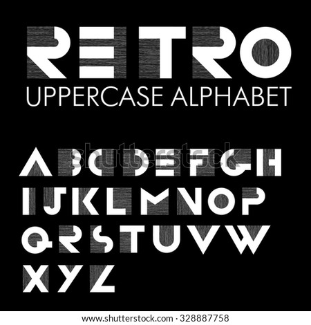 Wide decorative retro alphabet. White letters on black background - stock vector