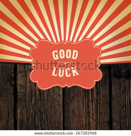 "Wild west styled ""Good Luck"" message on wooden board. With red rays background - stock vector"